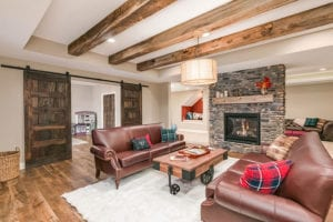 basement remodel with stone wall fireplace