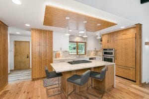 basement remodel with wet bar and kitchen