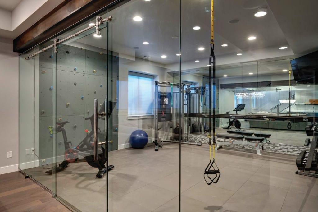HOME GYM | ROCK WALL AT HOME | glass door home gym | fbc remodel