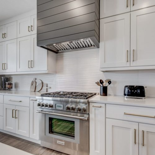 modern white and gray kitchen | fbc remodel | oven hood and range