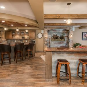 wood accents and ceiling lights | traditional basement remodel minnesota | fbc remodel